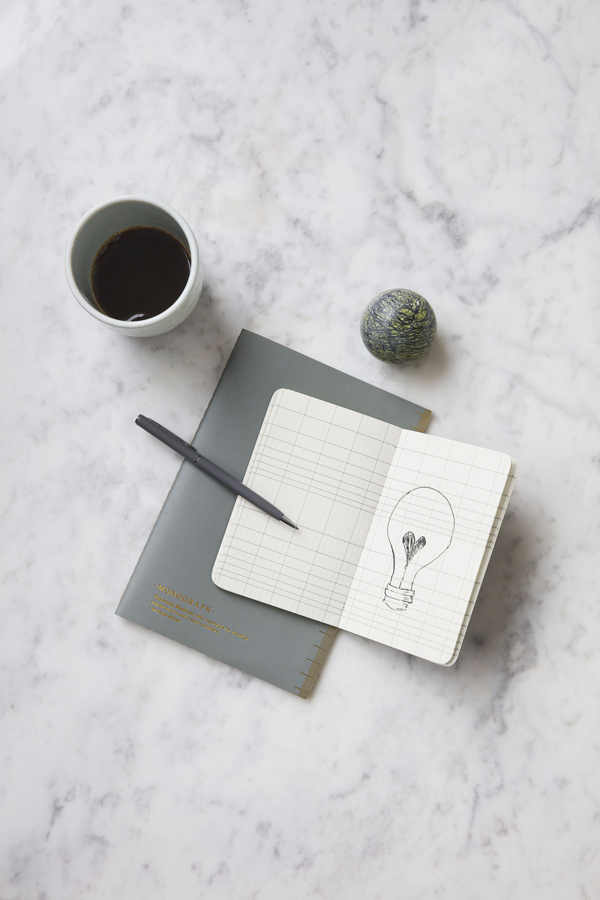 Monograph Paper Weight